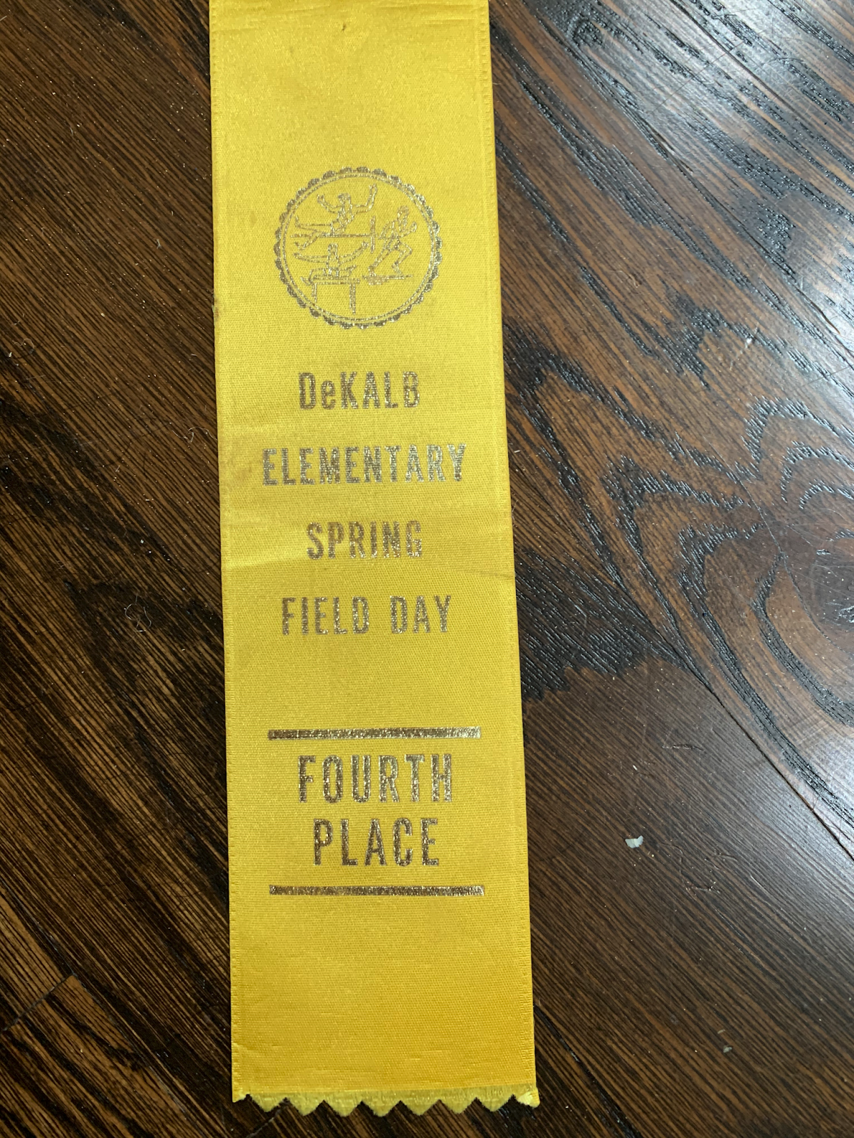 Ribbon for earning fourth place at field day at DeKalb Elementary School